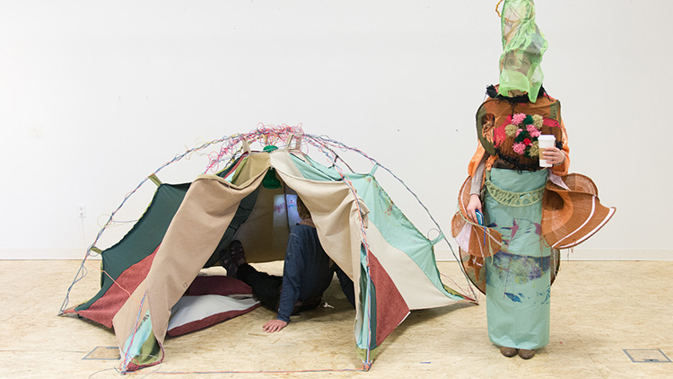 Anya Wild, tent and person in costume
