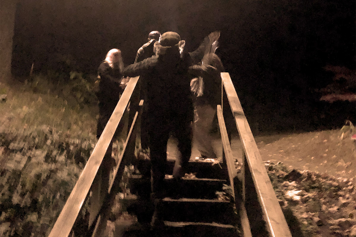 Photo of staircase with people at night