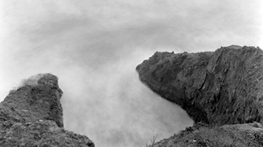 black and white photo of sea cliffs