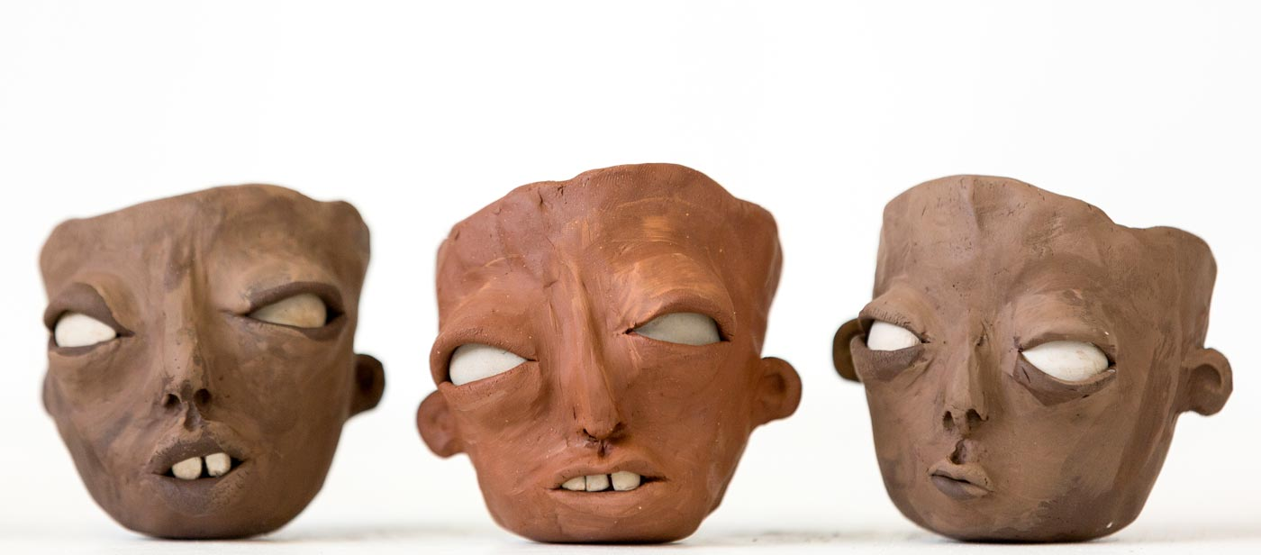 three ceramic heads