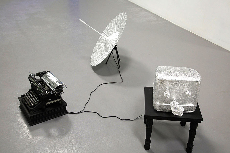 The transcodes, by Fei Chen: tin foil, umbrella, TV monitor, typewriter, wire, wood, paint