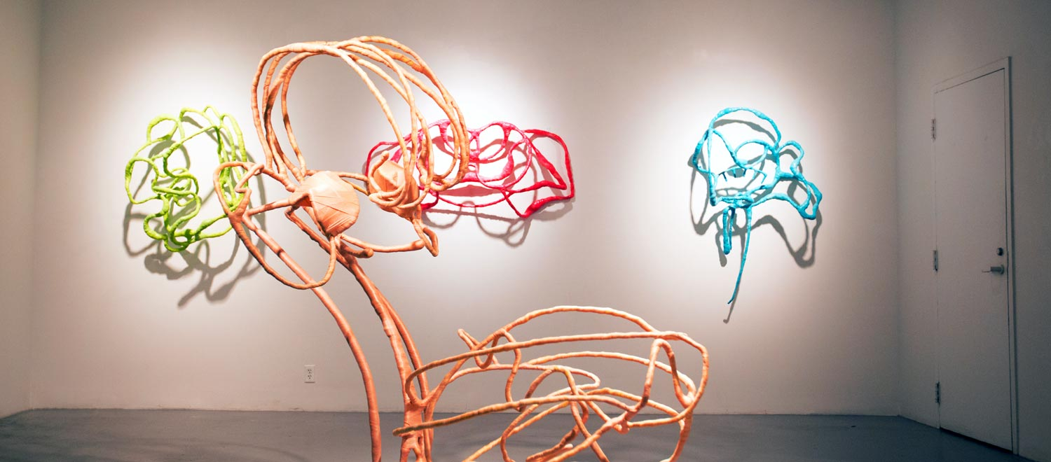 four colorful sculptures on display in gallery