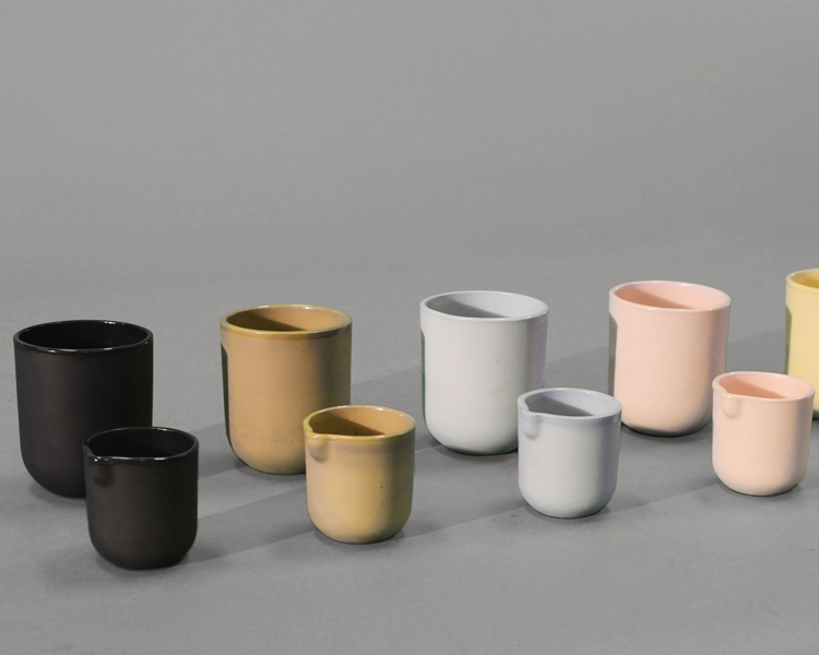 ceramic cups and matching creamers