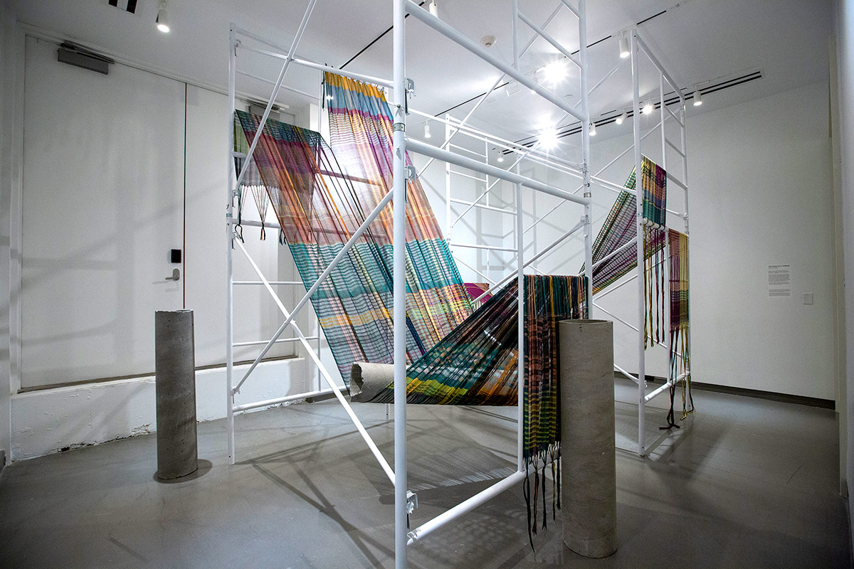photos of fiber art weaving in gallery