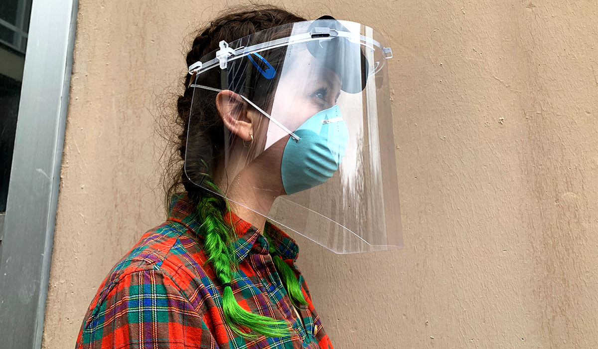 Student Geordi Helmick wearing a face shield