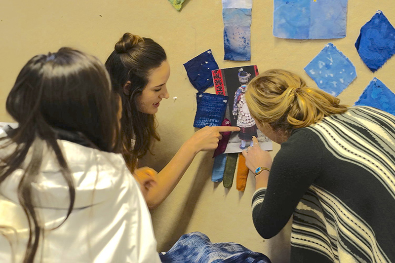Students examine dyed textile swatches