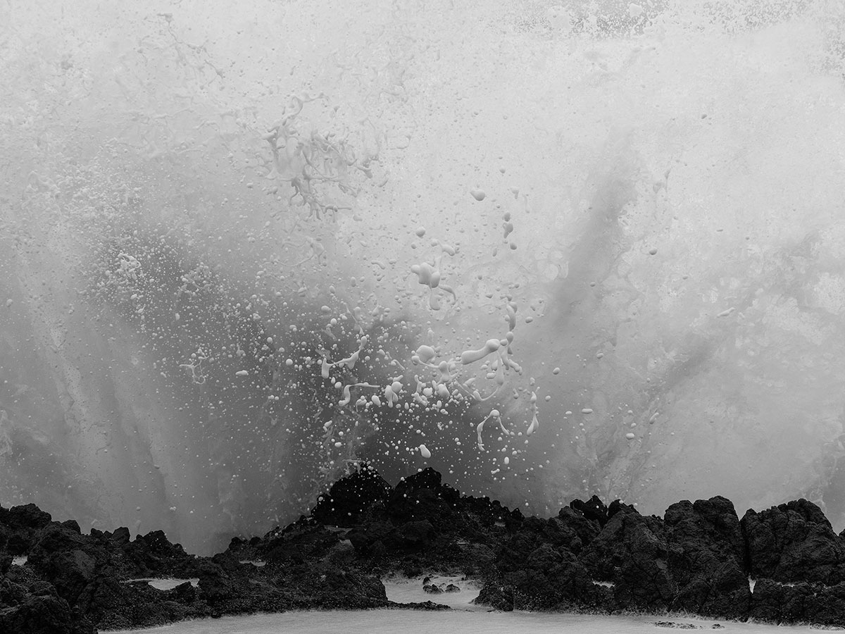 Black and white photo of a wave crashing
