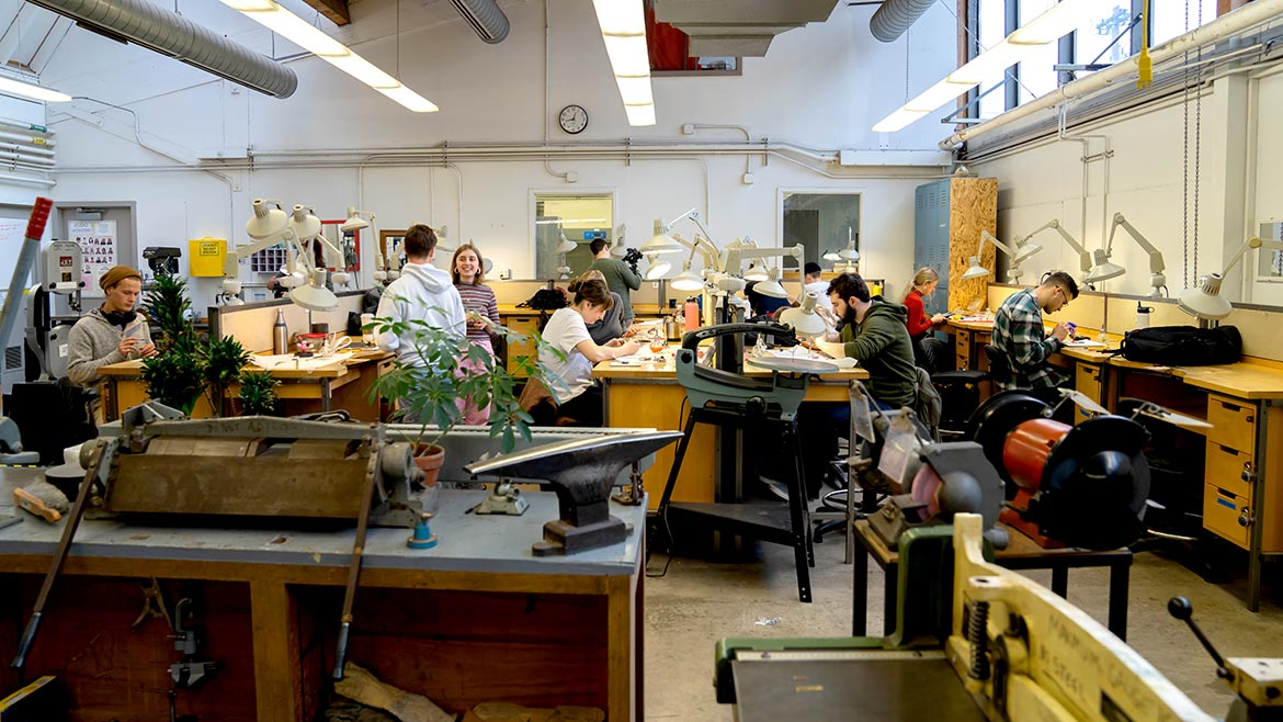 students at work in metalsmithing studio