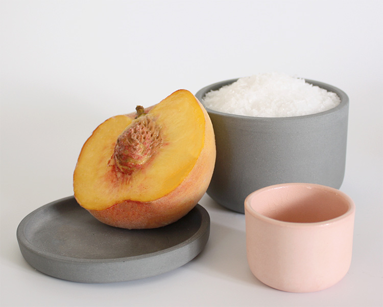 ceramic bowls and peach by Julia Sherman and Thomas Sprott