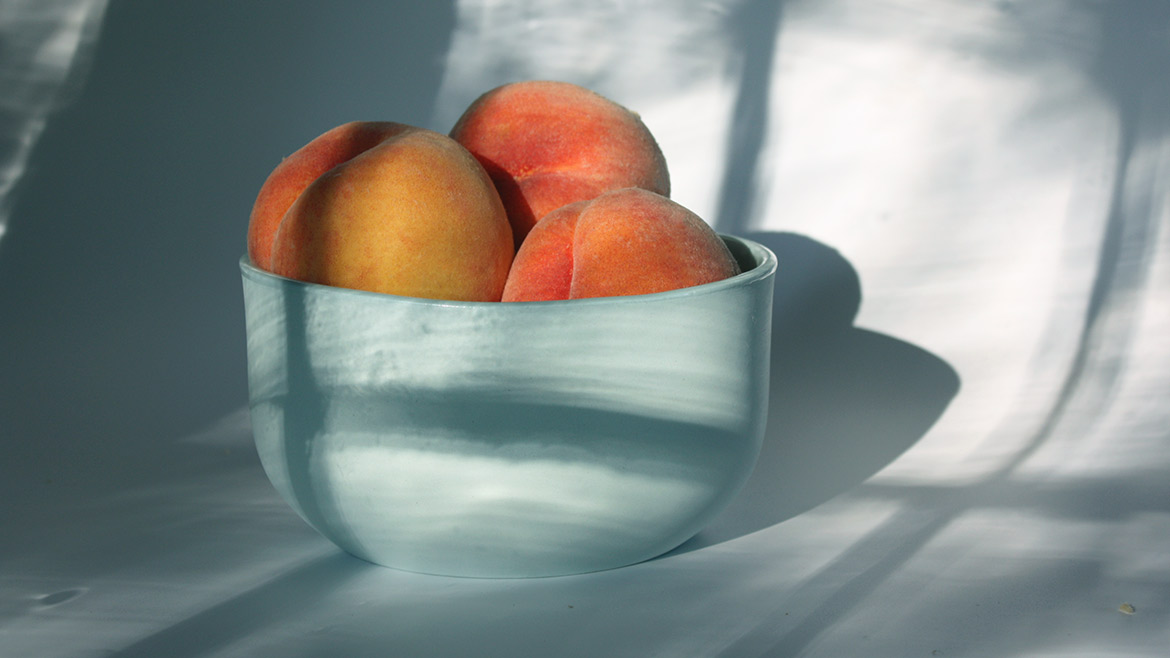 ceramic bowl with peaches by Julia Sherman and Thomas Sprott