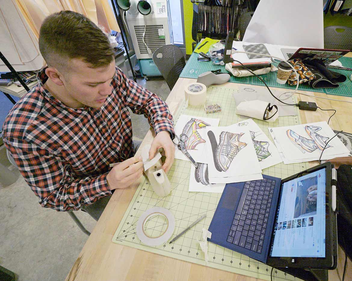 student works on shoe design