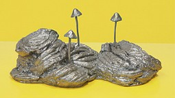 Silver mushroom on yellow artwork by Donald Morgan