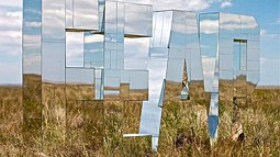 Photo of mirror sculpture in field
