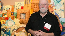 Artist George Green stands in front of his painting