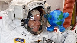 astronaut anne mcclain with earth toy