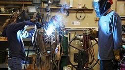 Metal sculptor Jud Turner, BA fine arts, '95, mentors middle school student Taja Kester