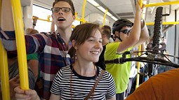students ride on TriMet light rail