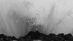 Black and white photo of a wave crashing