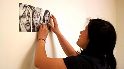 Kezia Setyawan adheres photo to wall